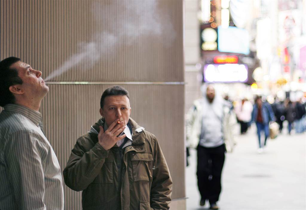 Smokers stand outside of an office building in New York City in 2009. Lucas Jackson/ Reuters